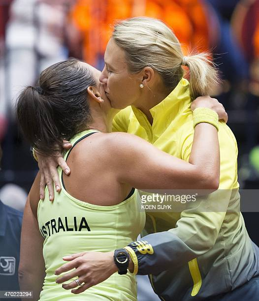 Australian tennis player Casey Dellacqua celebrates her victory against Dutch player Arantxa Rus after their Fed Cup tennis match in Den Bosch the...
