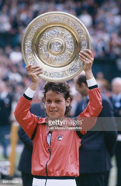 Australian tennis player Evonne Goolagong Cawley pictured raising the Venus Rosewater Dish trophy in the air after defeating Chris EvertLloyd to win...