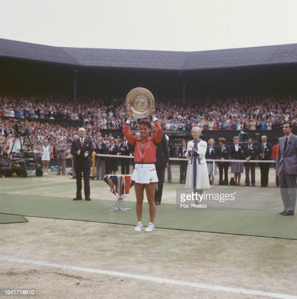 Australian tennis player Evonne Goolagong Cawley wins the Wimbledon Ladies Singles trophy 4th July 1980 Behind her and to the right is the Duchess of...