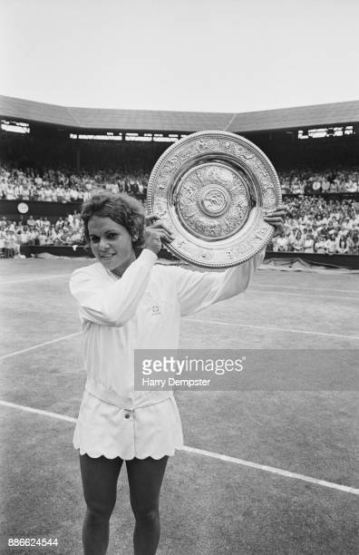 Australian tennis player Evonne Goolagong holds the Women's Singles Trophy after winning the final at the Wimbledon Lawn Tennis Championships, All...