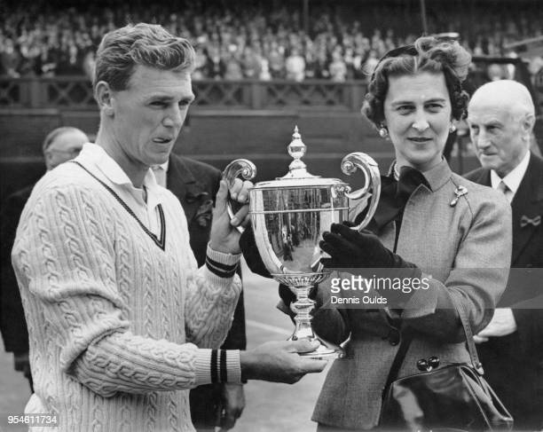 Australian tennis player Frank Sedgman receives a cup from the Duchess of Kent after beating Jaroslav Drobny on the Centre Court at Wimbledon, to win...