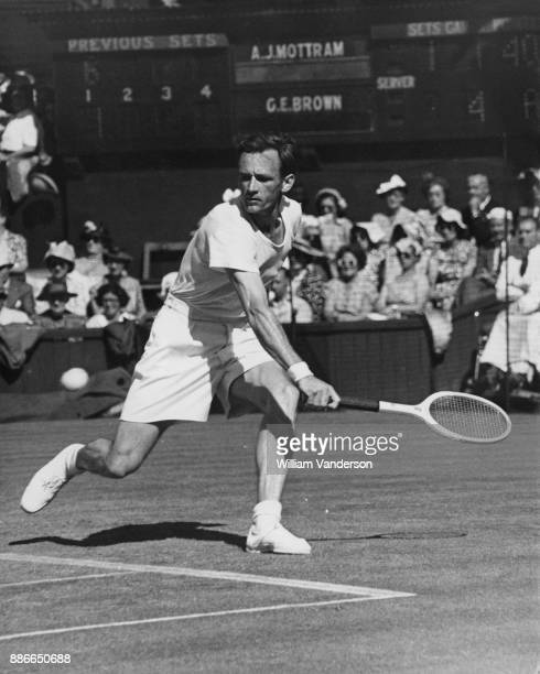 Australian tennis player Geoff Brown in action against England's Tony Mottram on the Centre Court at Wimbledon during the tennis championships 29th...