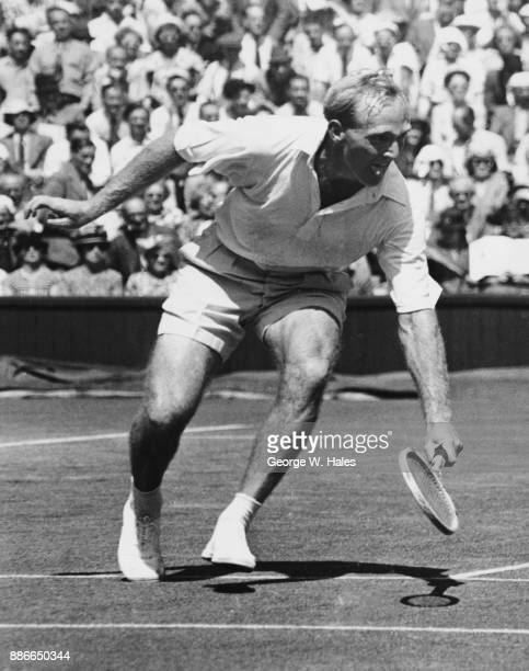 Australian tennis player John Bromwich in action against Eustace Fannin of South Africa on Centre Court during the third day of the men's singles at...
