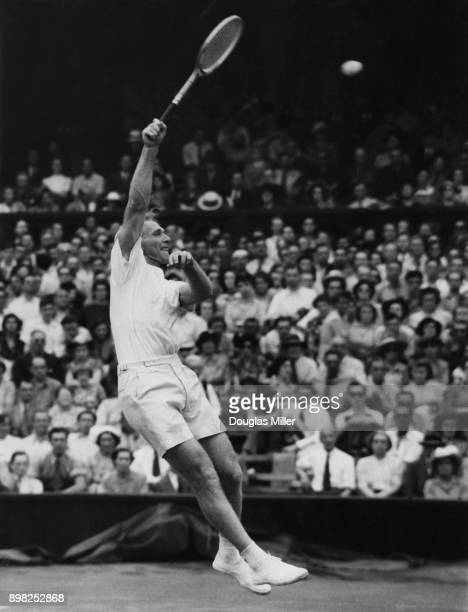 Australian tennis player John Bromwich in action against Jaroslav Drobny of Czechoslovakia in the semifinal of the men's singles at Wimbledon London...