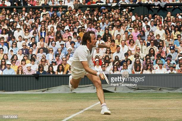 Australian tennis player John Newcombe in action against Stan Smith of the USA during the Men's Singles final at the Wimbledon Lawn Tennis...