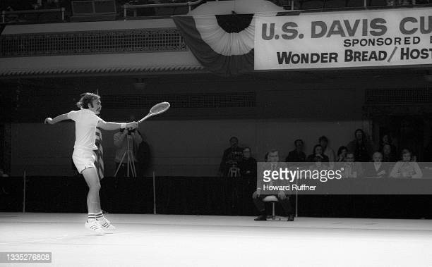 Australian tennis player John Newcombe jumps during a match on the first day of the 62nd Davis Cup final, Cleveland, Ohio, November 30, 1973. Various...