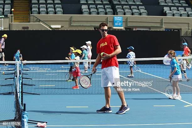 Australian tennis player John Peers plays tennis with kids at Memorial Drive Tennis court during the 2017 World Tennis Challenge Kids Day on January...