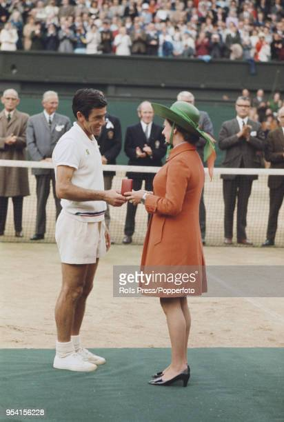 Australian tennis player Ken Rosewall is presented with the runner's up medal by Princess Margaret Countess of Snowdon after being defeated by John...