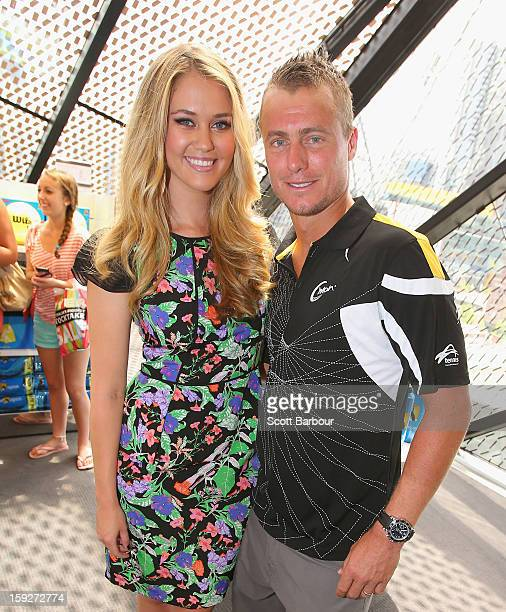 Australian tennis player Lleyton Hewitt poses with model ScherriLee Biggs as he launches his new C'mon range of apparel at Myer Melbourne on January...