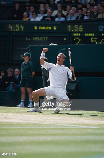 Australian tennis player Lleyton Hewitt sinks to his knees after defeating David Nalbandian to win the final of the Men's Singles tournament 61 63 62...