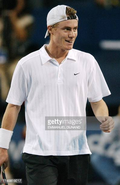 Australian tennis player Lleyton Hewitt smiles after winning a point 14 November 2002 during his match against Russia's Marat Safin at the Tennis...