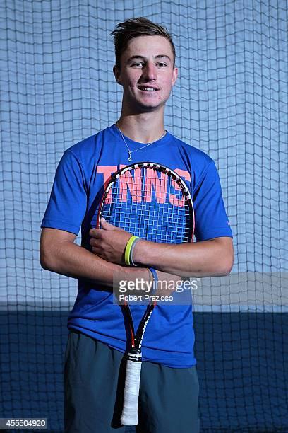 Australian tennis player Omar Jasika poses for photos during a media opportunity at Melbourne Park on September 16 2014 in Melbourne Australia