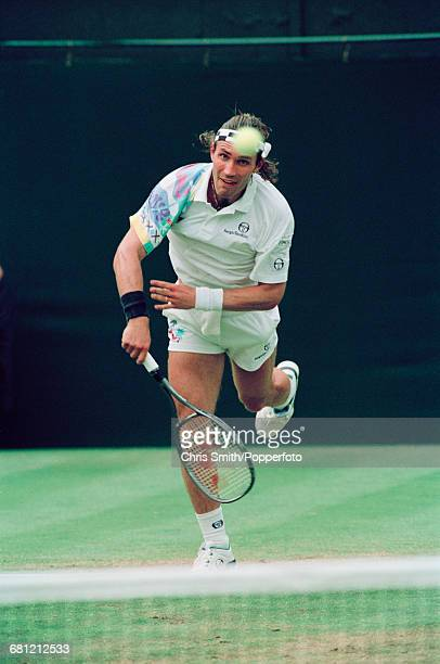 Australian tennis player Pat Cash pictured in action to lose to American tennis player John McEnroe 67 64 67 63 62 in the second round of the Men's...
