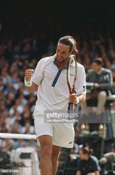 Australian tennis player Pat Rafter pictured competing to progress to reach the final of the Men's Singles tournament before losing to Pete Sampras...