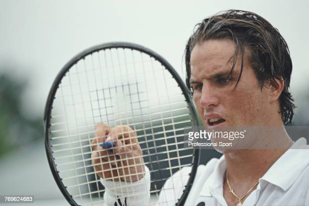 Australian tennis player Patrick Rafter pictured during competition to reach the fourth round of the Men's Singles tournament at the Wimbledon Lawn...