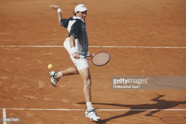 Australian tennis player Patrick Rafter pictured in action during competition to reach the semi finals of the Men's Singles tennis tournament at the...
