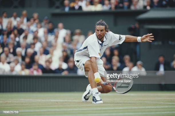 Australian tennis player Patrick Rafter pictured in action during competition to reach the final of the Men's Singles tournament at the Wimbledon...