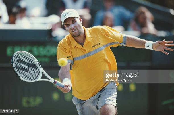 Australian tennis player Patrick Rafter pictured in action during competition to reach the semifinals of the Men's Singles event at the 2001 Ericsson...
