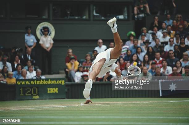Australian tennis player Patrick Rafter pictured tumbling over as he attempts to return a shot from Goran Ivanisevic of Croatia in the final of the...