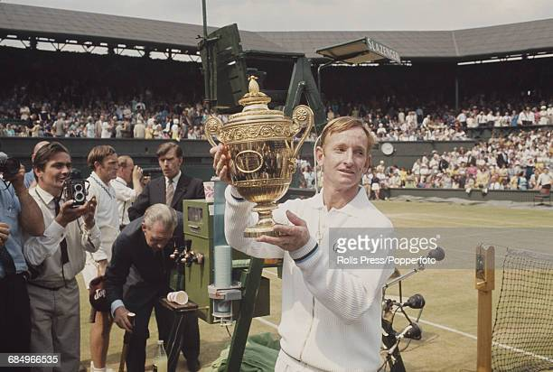 Australian tennis player Rod Laver holds the Gentlemen's singles trophy after winning the Men's Singles final against his fellow countryman Tony...