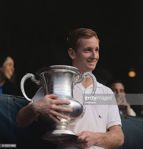 Australian tennis player Rod Laver holds the US Open trophy after defeating fellow countryman Roy Emerson 62 64 57 64 in the men's singles title With...