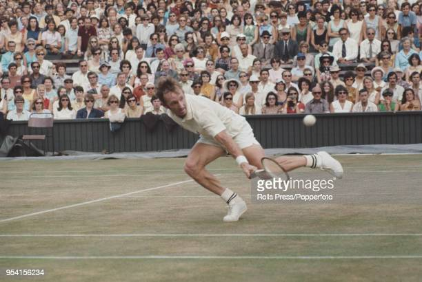 Australian tennis player Rod Laver pictured in action during competition to reach the fourth round of the Men's singles tournament at the Wimbledon...