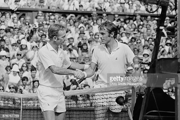 Australian tennis player Rod Laver shakes hands with fellow Australian tennis player John Newcombe after winning the final of the Men's Singles...