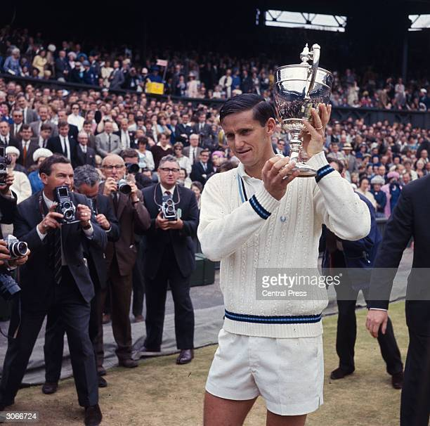 Australian tennis player Roy Emerson with the men's singles trophy after beating fellow Australian Fred Stolle in the final at the Wimbledon Lawn...