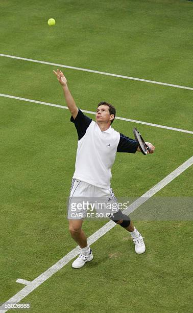 Australian tennis player Scott Draper serves during his match against Romanian Victor Hanescu at Queens Tennis club on the first day of the Stella...