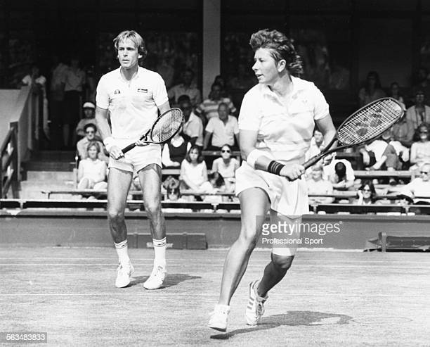 Australian tennis player Wendy Turnbull and English tennis player John Lloyd pictured together in action during a mixed doubles match at Wimbledon...
