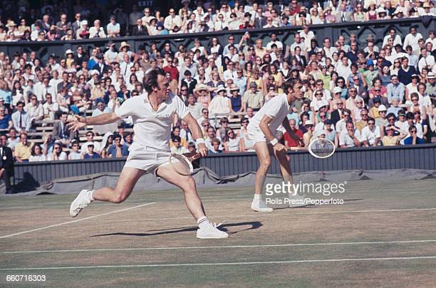 Australian tennis players John Newcombe and Tony Roche pictured in action together during the final of the Men's Doubles tournament at the Wimbledon...