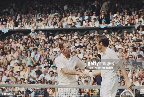 Australian tennis players Rod Laver and John Newcombe shake hands over the Centre Court net after Laver's victory over Nemcombe in the final of the...
