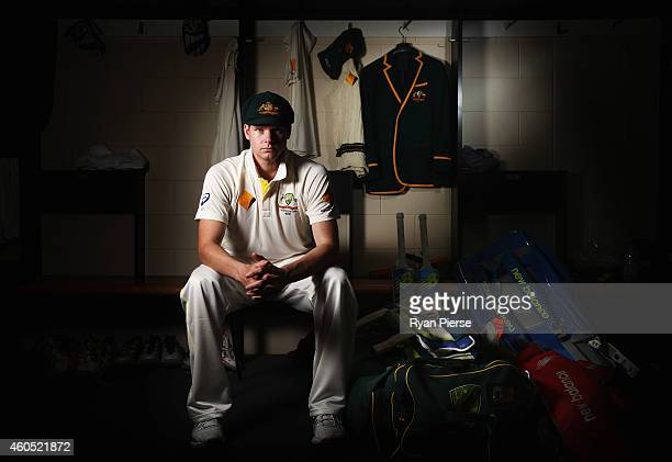 Australian Test captain Steve Smith poses with his captain's blazer during a portrait session at The Gabba on December 16, 2014 in Brisbane,...