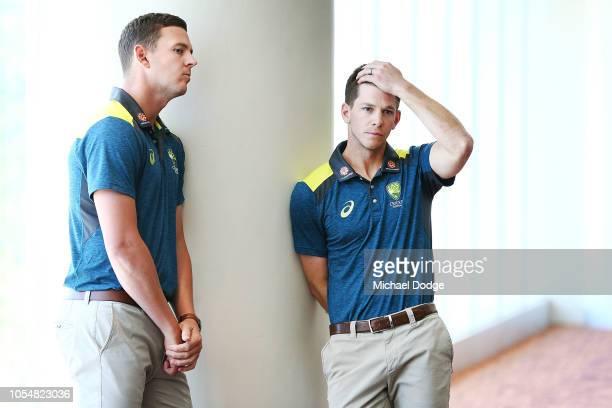 Australian Test Captain Tim Paine and Co ViceCaptain Josh Hazlewood listen on as Cricket Australia Chairman David Peever speaks during a Cricket...