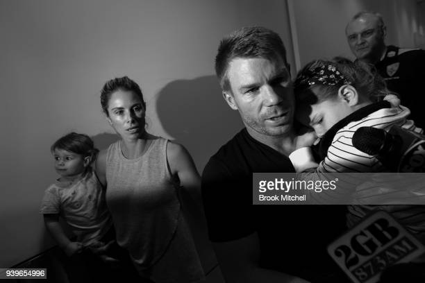 Australian Test cricketer David Warner arrives at Sydney International Airport to a waiting media pack on March 29 2018 in Sydney Australia Steve...