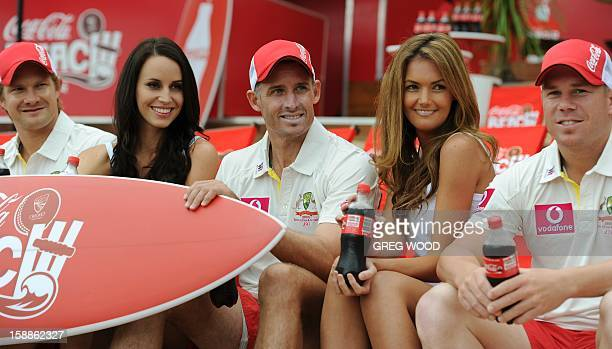 Australian Test cricketer Michael Hussey with teammates Shane Watson and David Warner and models Lauren Vickers and Amber Bernauer enjoy the world's...
