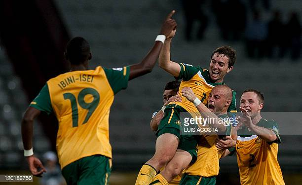 Australian Thomas Oar celebrate with Marc Warrent and other teammates after scoring against Ecuador during the FIFA Under20 World Cup football match...