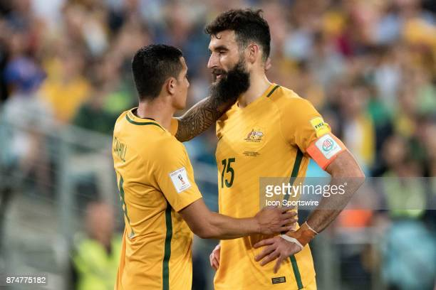 Australian Tim Cahill wishes Australian Mile Jedinak all the best for his penalty shot at the Soccer World Cup Qualifier between Australia and...