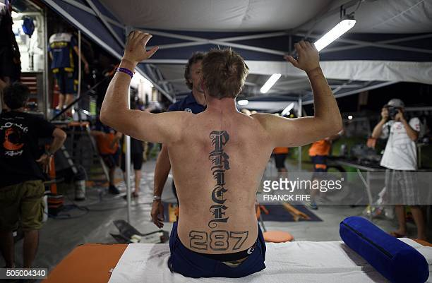 Australian Toby Price stretches in the bivouac after the Stage 10 of the Dakar 2016 between Belen and La Rioja Argentina on January 13 2016 won the...