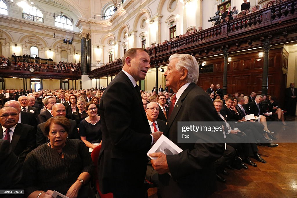 Australian Tony Abbott and former Prime Minister Bob Hawke shake hands at the state memorial service for former Australian Prime Minister Gough Whitlam at Sydney Town Hall on November 5, 2014 in Sydney, Australia. Gough Whitlam was the 21st Prime Minister of Australia. He died on October 21, aged 98.