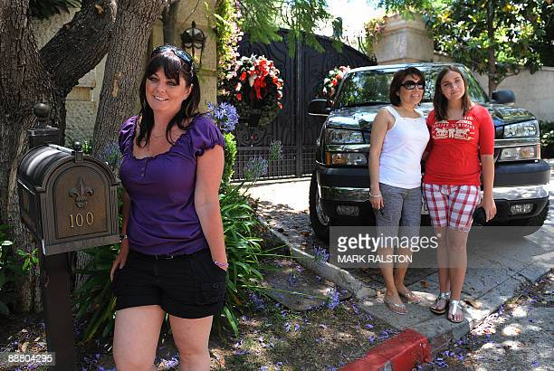 Australian tourist Belinda Williams of Melbourne poses for a photo outside the gates of the rented Holmby Hills home of music legend Michael Jackson...
