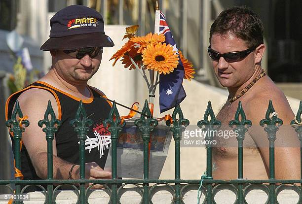 Australian tourists Glenn Woollard and Damien Mahnoney mourn for their friend in Kuta Bali 11 October 2004 Indonesia on Tuesday marks two years since...