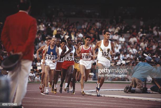 Australian track and field athlete Ron Clark leads from the rest of the field in the Men's 5000 metres event inside the Estadio Olimpico at the 1968...
