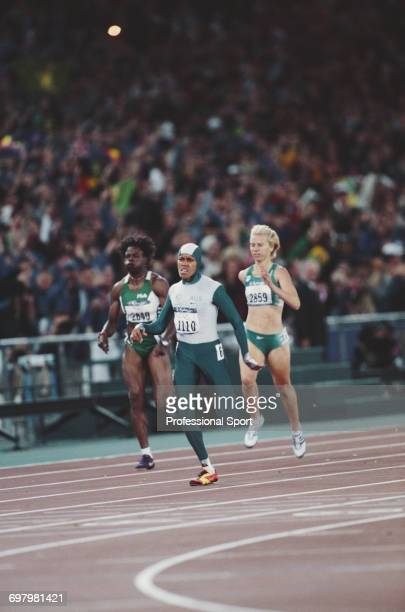 Australian track athlete Cathy Freeman pictured in action wearing a one piece body suit competing to finish in first place to win the gold medal in...