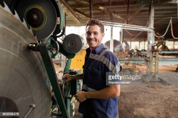 Australian tradesman using machinery equipment