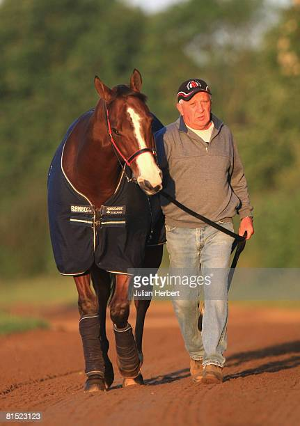 Australian trained horse Takeover Target is lead by trainer Joe Janiak to the gallops in Newmarket on June 11 in Newmarket England The horse is due...