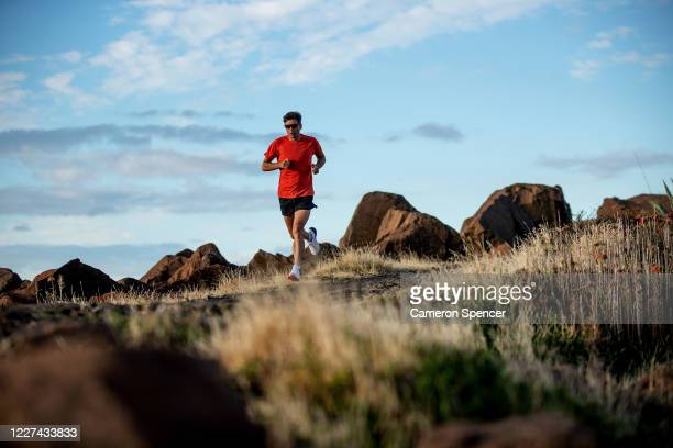 Australian triathlete Aaron Royle runs during a training session around Wollongong Harbour on May 27 2020 in Wollongong Australia Royle usually...