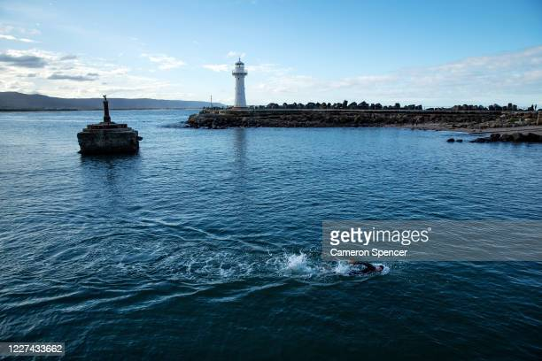 Australian triathlete Aaron Royle swims during a training session in Wollongong Harbour on May 27 2020 in Wollongong Australia Royle usually spends...