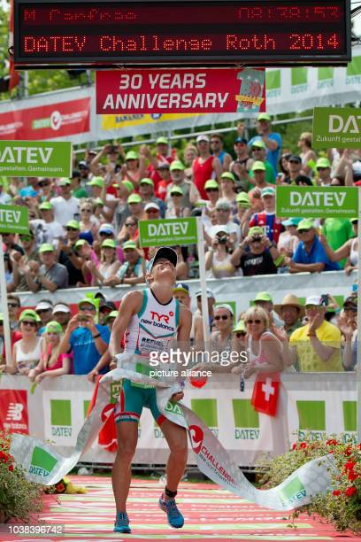 Australian triathlete Mirinda Carfrae cheers as she crosses the finishing line to win during the Datev Challenge Roth inRoth Germany 20 July 2014...