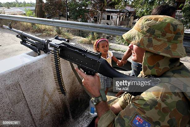 Australian troops at a vehicle checkpoint in the East Timorese capital Dili The troops have been stationed there as a peacekeeping force after the...